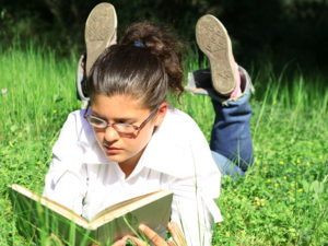 How can I help my older child or teen who doesn't read for pleasure to build good reading habits?